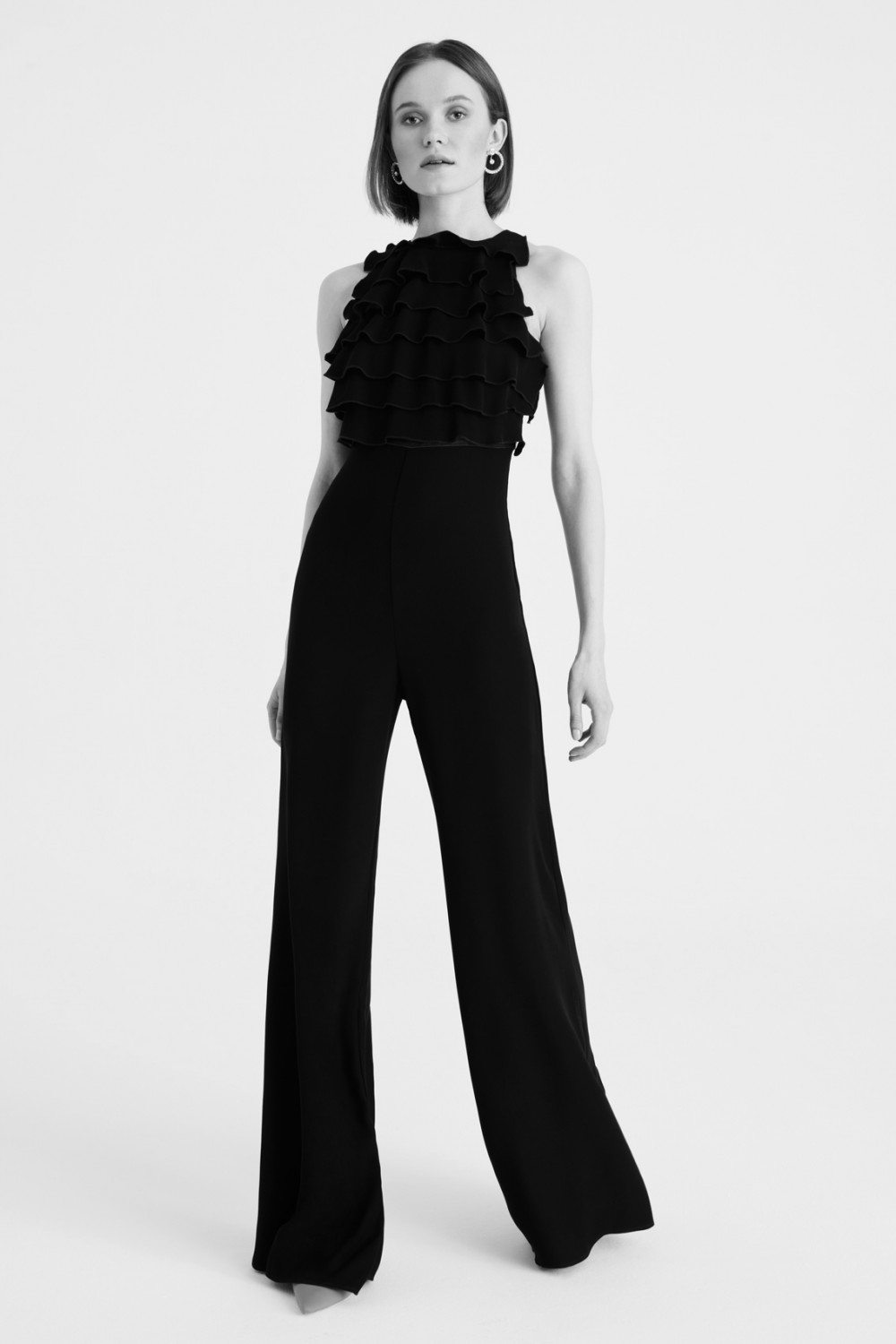 Jumpsuit nera in crepes con rouches