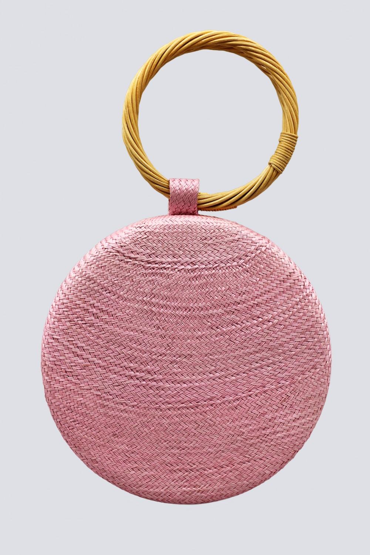 Clutch rosa con manico in vimini
