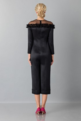 Jumpsuit nera longuette con pizzo off shoulderBlumarine