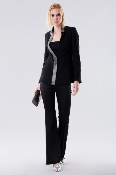 Completo con pantalone e giacca con strass