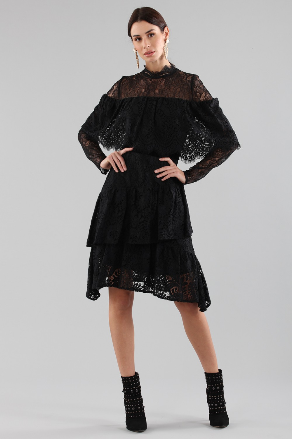 Short black dress with flounces and cape sleeves