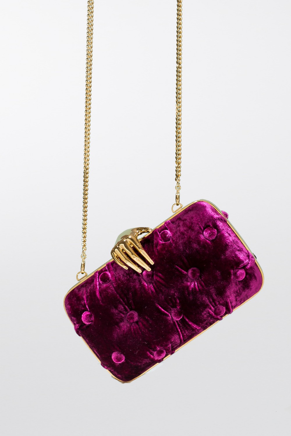 Purple velvet clutch with hand closure