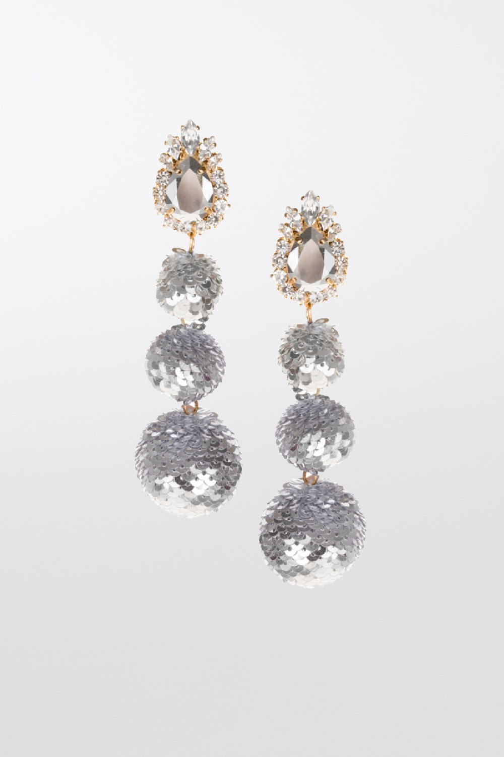 Earrings in silver sequins