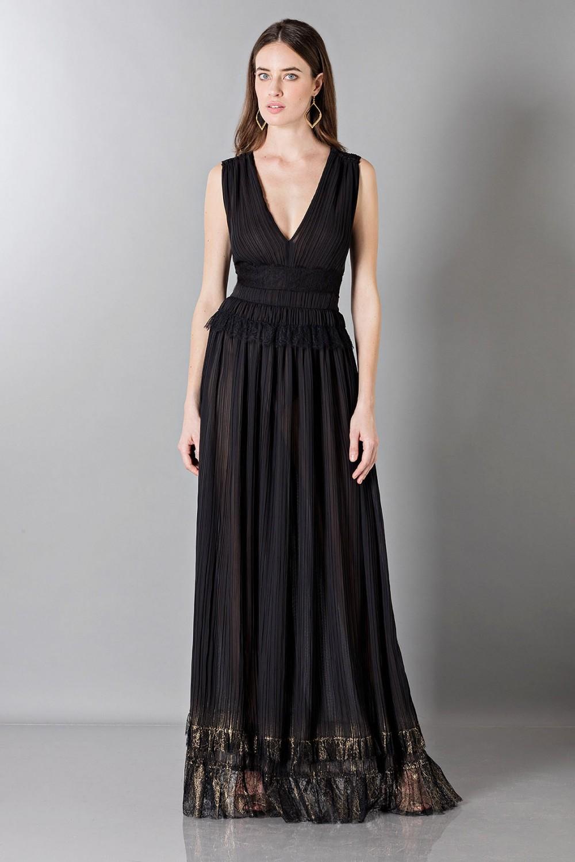 Floor-length black dress with V-neckline