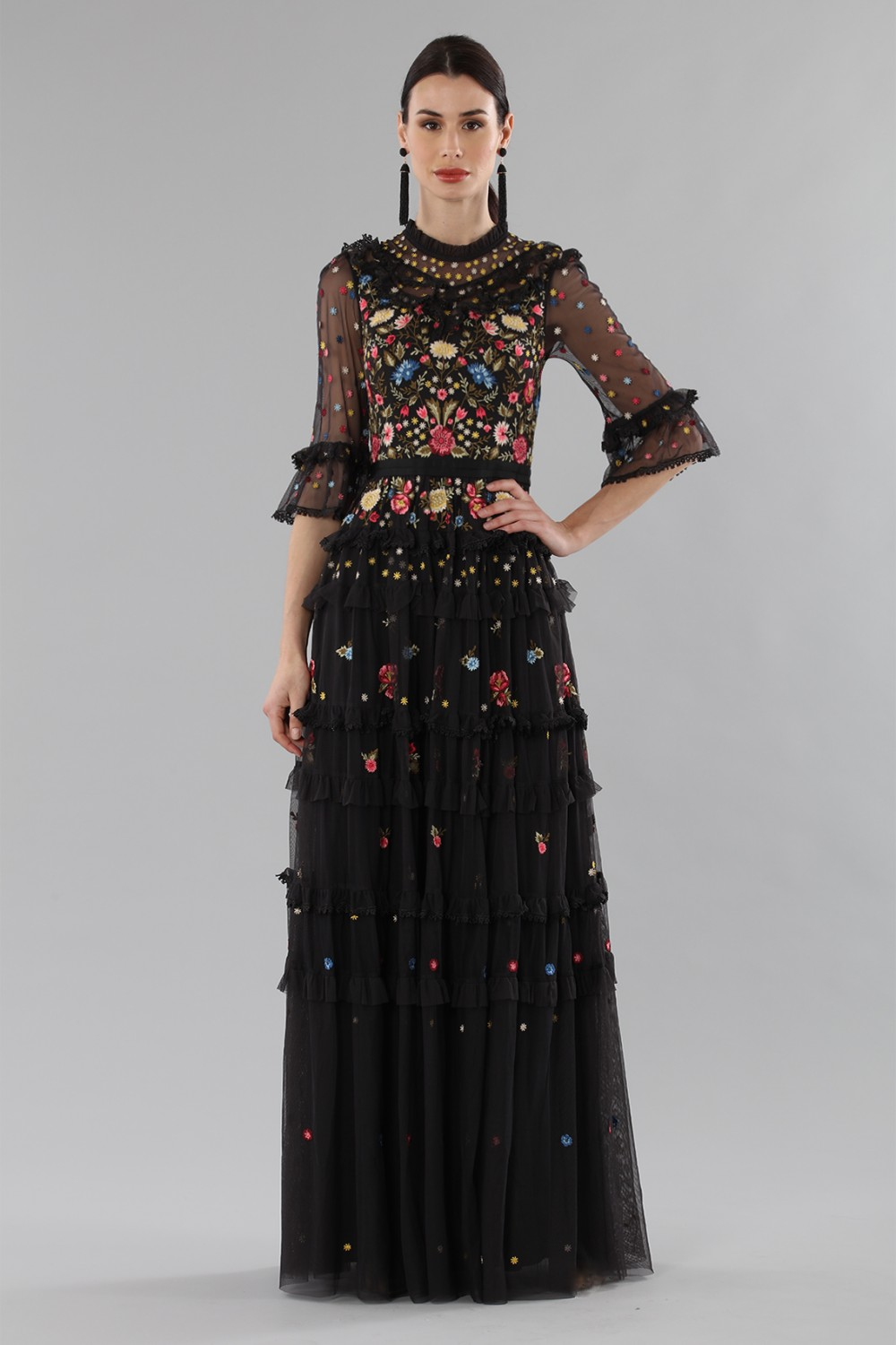 Long black dress in tulle with floral decorations