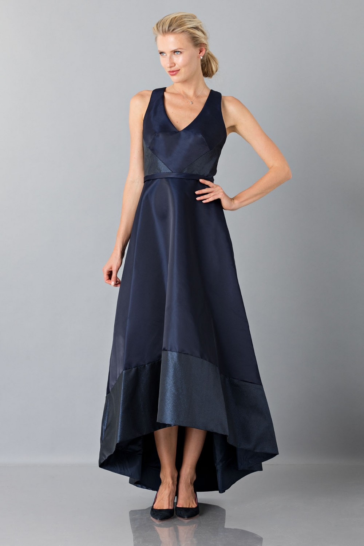 Long asymmetric V-neck blue dress.