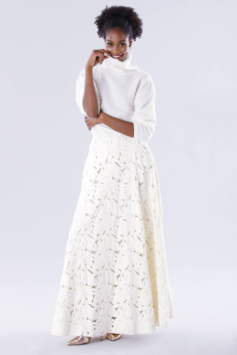 White suit with paisley skirt and sweater