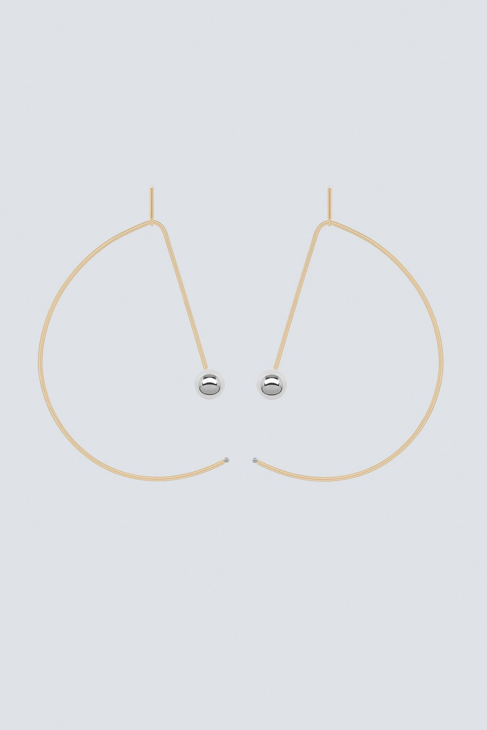 Reversible gold and palladium earrings