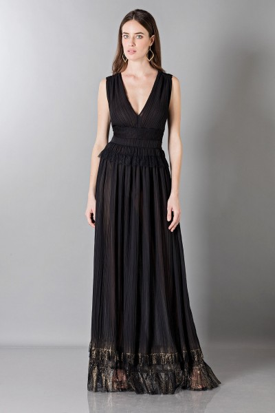 Floor-length black dress with V-neckline