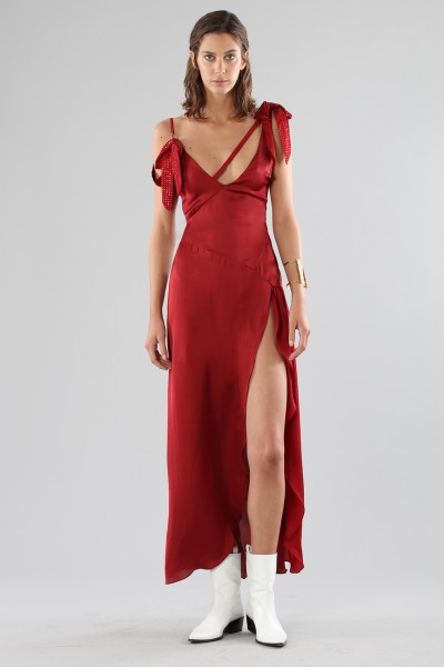 Red dress with appliqué bows and deep necklines